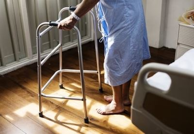 Man with a walker at a hospital